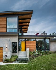 Colorful front door in yellow welcomes you at the cool Texas Home Mid Century Modern Aesthetics Shape Posh Texas Home In Wood, Glass And Steel