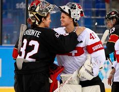 fc7e61ee64c Goaltenders Charline Labonté (Canada) and Florence Schelling (Switzerland)  share an Olympic embrace post-game in Sochi.