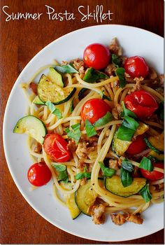 Fresh zucchini and cherry tomatoes are sauteed in extra virgin olive oil and garlic, then tossed with spicy chicken sausage, spaghetti, and torn basil in this ultra-summery skillet supper.