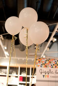 Balloons tied with gold tassels were a must! #diy