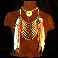 """Beautiful Native American bone & turquoise loop necklace & choker set adorned with turquoise nuggets, antiqued """"bone"""" discs, brass conchos & ermine skins. 2 pieces. Each piece can be worn separately."""