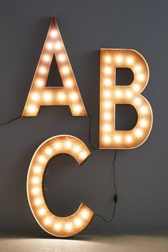 "Monogram Marquee Light - anthropologie.com  warm, amber glow, these marquee-inspired lights bring an air of nostalgia to your home theater or living room. Group them in multiples to spell out your initials or name.        Available in letters A-Z     Hanging hardware required     Includes 10-30 light bulbs     7 watt max     Metal, glass     36""H, 6"" - 30""W     5"" projection     20"" cord     USA      Style No. 32927063"