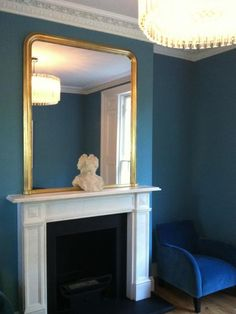 Bright gilt resplendently set against a bold paint Living Room Mantle, Living Room Sofa, Dining Room Colors, Home Wall Colour, Teal Sofa Living Room, Home Decor, Living Room Mirrors, Living Room Wall, Room Colors