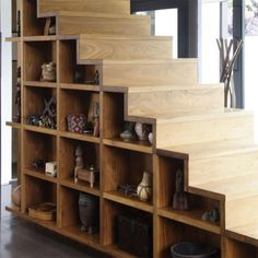 Staircases are often used for storage. This staircase wall features built-in storage compartments.