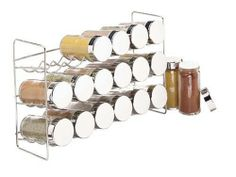 Spice Rack - 18 Bottle by Polder by Polder. $26.99. This spice rack by Polder includes 18 clear glass jars with chrome screw-on lids and plastic shaker tops. The three tiered wave design can securely hold 6 jars on each tier. Can stand freely or be mounted to the wall. Spices are not included.