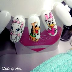 by Aneta Bykowska :) Follow us on Pinterest. Find more inspiration at www.indigo-nails.com #nailart #nails #indigo #disney #pluto #daisy #icon #cartoon