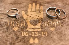 With careers in graphic design, this wedding took DIY to a whole new level. Pictured here: a personalized wood engraving to display the bride and groom's wedding rings. | Jamie & Josh's Sweet Spencer, MA Real Wedding by Zac Wolf Photography #myweddingmag