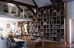 I would love to have a room with a bookcase like this:)