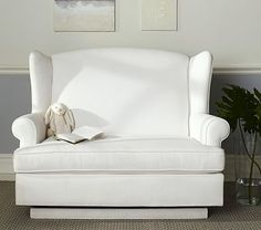 We crafted this plush glider with nursing mothers' needs in mind. It's built to provide ample, comfortable room, and offers an extra-supportive headrest and armrests.