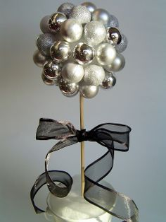 diy New Year's Topiary: ornaments glued to a styrofoam ball @ http://lightingworldbay.com for more information - you may need to look around the site