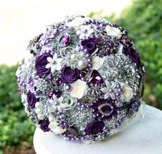 Brooch Purple Wedding Bouquet. Deposit on made to order broach heirloom brooch bouquet.. $75.00, via Etsy.