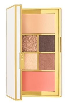 A reflective ivory-and-gold colored palette opens to reveal a collection of hues for eyes and cheeks by Tom Ford.