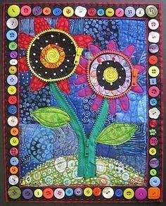 Jamie Fingal's quilt. Love the buttons around edges, zipper stems.