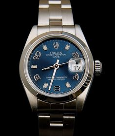 Ladies Rolex Date. Stainless steel, smooth bezel oyster band with blue dial. Year: 2000 1/2| Chronometer: COSC Certified | Size: 26 mm | Material: Stainless Steel | Bezel: Smooth   Dial: Blue | Water Resistant: Waterproof to 100 metres/330 feet | Movement: Self-winding | Bracelet: Oyster Band. Price: Call For Availability And Price Quote. See more at londoncoin.com