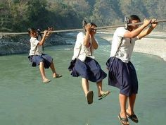 Girls on their way to school in Nepal. No bridge, no other way to get there. Bravest girls in the world. pic.twitter.com/YdaTvTJwQo