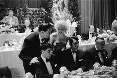 Marilyn with Milton Berle, Jerry Lewis and Dean Martin at the Friars Club Testimonial Dinner, March 11th 1955.