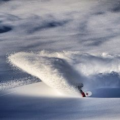 Annie Boulanger with a serious powder turn.  Beautiful photo. Photo: Oli Gagnon  #snowboard #winter #photo