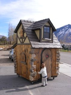 Here's the look I'm going for on the grain bin out back:  Storybook Cottage  Step into the pages of a child's storybook fable where your little people can dwell with the... more»  $3,800.00 | Fancy Builder, Inc.