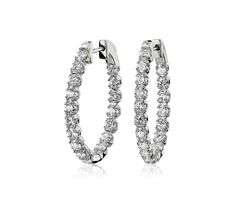 These stunning diamond hoop earrings feature 2 carats of round-cut diamonds double prong set in white gold. The oval shape of the hoops combined with the double prong setting elevates this classic jewelry box piece into something entirely unique. Diamond Hoop Earrings, Diamond Jewelry, Top Engagement Rings, White Gold Hoops, Diamond Shop, Wedding Ring Designs, Round Cut Diamond, Colored Diamonds, Fashion Rings