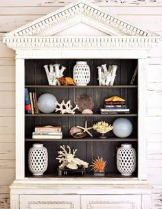 Make a coastal display pop by painting the back of a cabinet in a contrasting color like this charcoal grey: http://www.completely-coastal.com/2014/09/modern-tropical-decor-pink.html