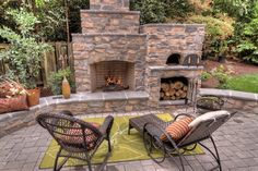 Outdoor fireplace with brick stone oven. Paradise Restores Landscape Contractors