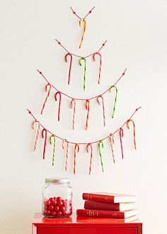 Cheap DIY Christmas Tree Decorations - candy canes and string. More info: http://www.midwestliving.com/holidays/christmas/5-clever-and-cheap-diy-christmas-tree-alternatives/?page=1