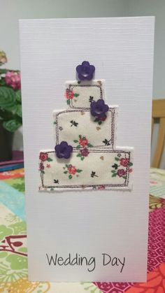 Handmade applique fabric card. Purple flower wedding cake.