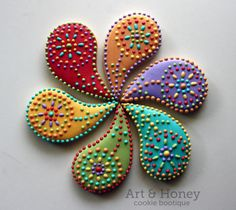 i'm not a flowery person, but interesting concept using a paisley flower design. dots, points of connection, colors, petals, droplets, dots within shapes and circles...