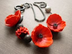 Poppy polymer clay necklace. $95.00, via Etsy.  the colors and form of this is just so perfect!