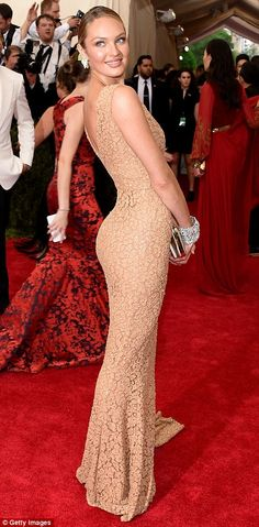 Racy in lace: Fellow Victoria's Secret star Candice Swanepoel looked radiant in a nude fro...