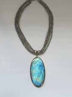 A dramatic style piece -- Four strands of faceted Labradorite gemstone beads adorned with a stunning highly chatoyant long oval Labradorite pendant, bezel-set in sterling silver. Labradorite Jewelry, Gemstone Jewelry, Beaded Jewelry, Beaded Necklace, Pendant Jewelry, Jewelry Art, Vintage Jewelry, Unique Jewelry, Jewelry Rings