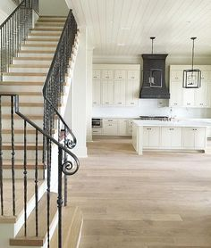Flooring: White oak with whitewash stain and metal bannister
