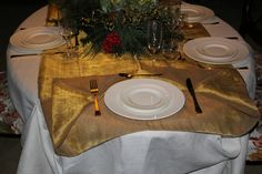 White linen hand embroidered early 800 and golden over tablecloth.