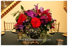 Red roses, purple vanda orchids, red cymbidium orchids and fuchsia stock with hydrangea and foliage