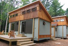 Shipping container houses with raised roofs