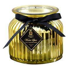 Luxury scented Christmas candle in a metallic gold ribbed glass jar. Fill your home with the seasonal fragrance of Winter Spice. Candle will burn for 50 hours approximately. Glass jar measures 11cm diameter by 11cm tall. Luxury candle in glass jar Shiny metallic finish Single wick Winter spice scent 50 hour burn time.  #timely #home_interiors #luxury_ideas #best_candles #home_scents #fragrance_oils