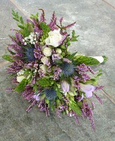 Bouquet - rose, freesia, eryngium, gypsophilia, chincherinchee, and heather