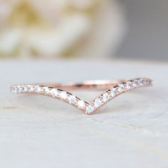 This V Chevron band Ring is made of flash rose gold, gold or rhodium plated brass and AAA Cubic Zirconia set in a micro pave setting. Stones are not