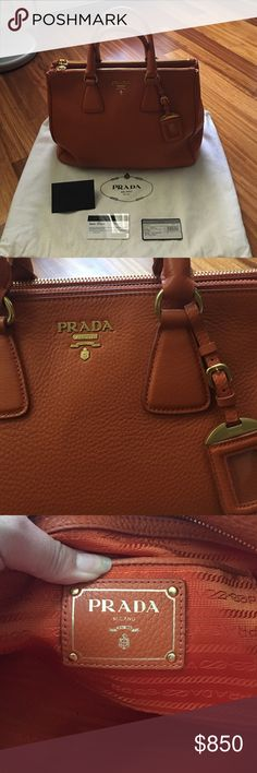 Prada Shopping Tote in Papaya Gorgeous bag by Prada in Vit Daino (pebble) leather. I have authenticity card with envelope, original tag & copy of receipt. The bag has four gold feet that's Slightly discolored from use. Bought this at the Prada outlet so it's made in China but  authentic! This will go trough Posh Concierge since it'll be over $500. Used this bag for less than 3 months and stored in closet. Truly more beautiful in person than in pics. Prada Bags Totes