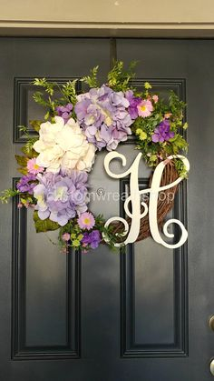 Spring Flowers Wreath for Door No matter where you call home, youll adore the beautiful and charming sensibilities of our exclusive Custom Wreath Quickly and easily adorn a door, window, or wall. Natural grapevine and artificial purple Hydrangeas and cream Hydrangeas ornate with