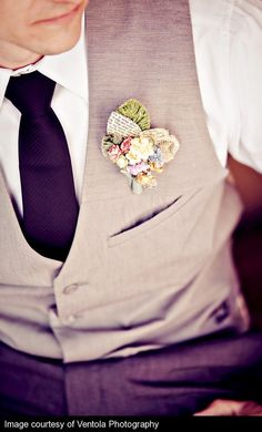 handsome grey vest & custom boutonniere (using the pretty green ribbon used on announcement?)