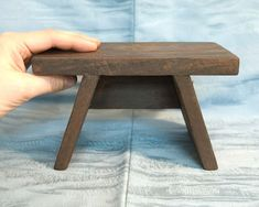 Description Small wooden Japanese bath stool.  Small wooden benches such as this are used in Japan to sit upon when bathing in the Japanese-style bath (furo).  The Japanese commonly clean their b…