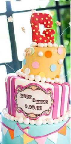 Circus Themed Cake From http://ruffledblog.com/rosie-mikes-carnival-inspired-fete/