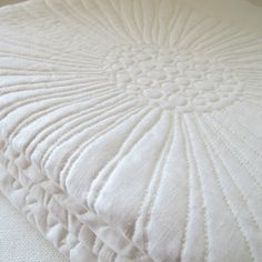 Image of crazy daisy heirloom quilt . snow