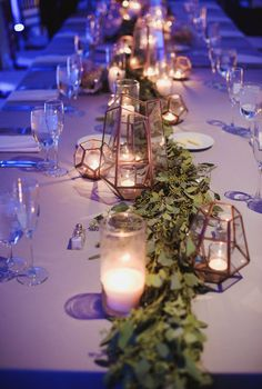 Wedding Reception head table with Anthropologie geometric copper hurricane votive lanterns and Eucalyptus greenery runner centerpieces by La Fleur du Jour  Baltimore Legg Mason Tower Wedding | East Made Event Company Baltimore Maryland Wedding Planner | Photo by Hannah Gunnell