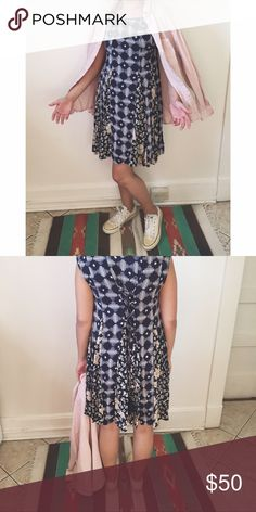 Navy blue dress with lace-up back Midi length navy blue and pink floral patterned dress with lace-tie-up back. Anthropologie Dresses Midi