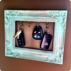 dorm room key holder. Pretty picture frame with the back and glass removed, then screw in the hooks to put your keys on!!  Hang with command strips, of course ;)