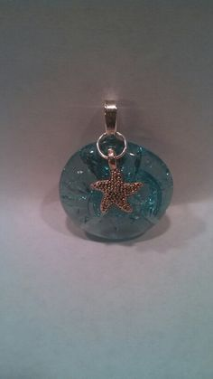 Fried glass flat back marble made into a pendant!  Just beachy!!!