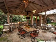 covered porch outdoor kitchen | The back yard features a covered patio area with an outdoor kitchen.