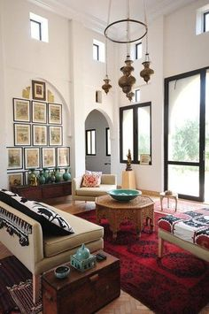 (BrandonRugs.com) Black and white and red allover. The hand-knotted Afghan rug, in radiant red and bible black, is the wild side that creates dynamic tension to counterbalance the restraint and composure in the rest of the room's furnishings.